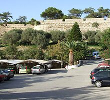 Parking Lot and Brick Wall on the Island of Crete in Greece by JaguarJulie