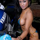 Bikini model getting soapy while washing a motorcycle by mcdesign
