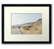 Camper Van Driving Through Dry Landscape Framed Print