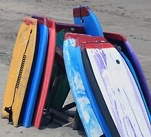 Stacked Boards on a Beach by rhamm