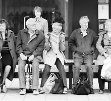 Bus stop queue by Trevor Coultart