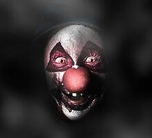 Dark evil clown face with scary joker smile by Ryan Jorgensen