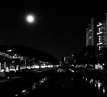 Full moon in urban night by Wing Yau Au Yeong