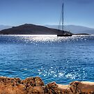 Yacht in front of Nissaki by Tom Gomez