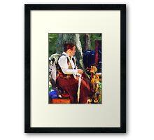 Woman Spinning Yarn at Flea Market Framed Print