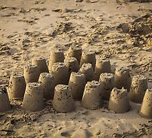 Castles in the sand by Andrew Dodds