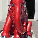 Red elephant on my road by bubblehex08