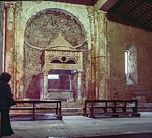 Marj looking at altar in apse end of church San Clemente Torre di Passeri 198404070016  by Fred Mitchell