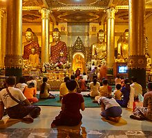 faithful Buddhists praying at Buddha Statues in SHWEDAGON PAGODA by travel4pictures