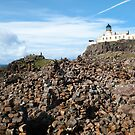 The Cairns in front of the Neist Point Lighthouse, Skye by Richard Flint