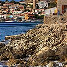 The rocky shore at Nimborio by Tom Gomez