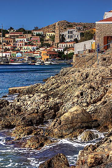 The rocky shore at Nimborio by Tom Gomez