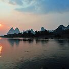 Sunset On The Li River, Yangshuo, China. by Ralph de Zilva