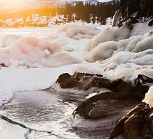 Warmth of orange sunlight on ice covered rocks by ImagoBorealis