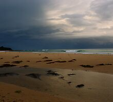 A quiet beach at dusk by imaginethis
