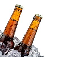 Beers on ice with copyspace isolated on white background by Pablo Romero
