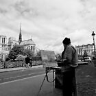 Artist at work - Notre Dame - Paris, France by Norman Repacholi