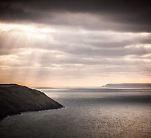 lundy island and baggy point on a dark afternoon by James Calvey