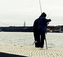 Occasional couple of fishers by Gonçalo Julião
