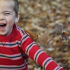 Laughing in the Leaves  by CcoatesPhotos