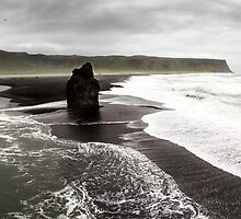 Isolated Rock: Black Beach at Dyrholaey, Iceland by thewaxmuseum