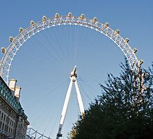 A blue sky over the London Eye on southbank in London by Keith Larby