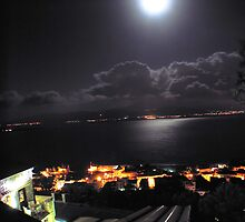 looking down at the moonlit sea by tbshots