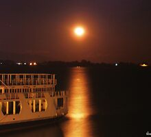 moon over ferry boat by tbshots