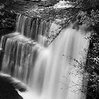 water fall in the fall of winter mono by yampy