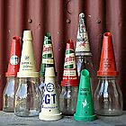 Old oil bottles by Julie Sherlock