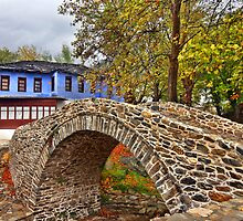 Stone arched bridge, indigo house by Hercules Milas