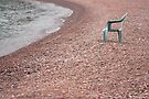 Empty Chair on Pebble Beach by April Koehler