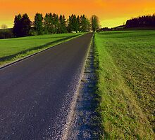 Country road into surreal sundown | landscape photography by Patrick Jobst
