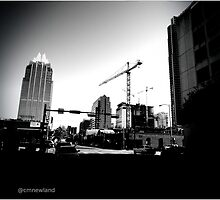 Cranes Over Austin. by Christopher  Newland