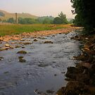 River and fields on a summer afternoon by Phill Sacre
