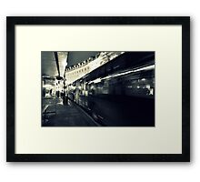 Waiting for the night bus in the dark city street Framed Print