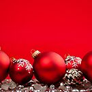 Red Christmas background with ornaments by Elena Elisseeva