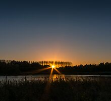 Sunset accross the lake by Ralph Goldsmith