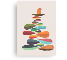 Bird nesting on top of pebbles hill Canvas Print