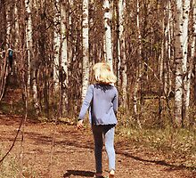 Young Girl Walking Down a Forest Path by rhamm