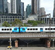 Flinders St. Rail and a modern city skyline. Melbourne. by Rita Blom