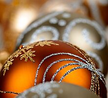 Gold Christmas ornaments closeup by Elena Elisseeva