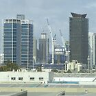 Melbourne's Tall Buildings from a bus window. by Rita Blom