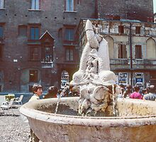 Fountain with spouting (dribbling) fish, square Mantova Italy 198404180032  by Fred Mitchell