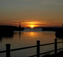 Sunset between piers at Maryport by john southward