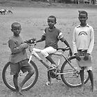 Three boys and a bicycle by David Perrin