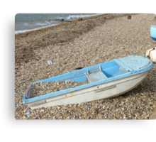 Boat on a beach Canvas Print