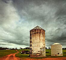 Silos in the storm. by Paul Amyes