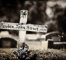 Graveyard Adornments #11 - Wooden cross & sun bleached plastic blue roses by Malcolm Heberle