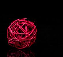 Red decoration ball by Tom Klausz